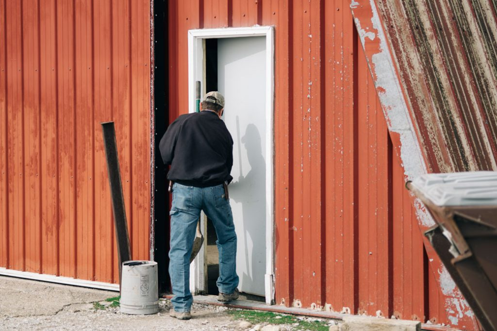 A farmer at a livestock farm in Fillmore, Indiana, on April 6, 2018.