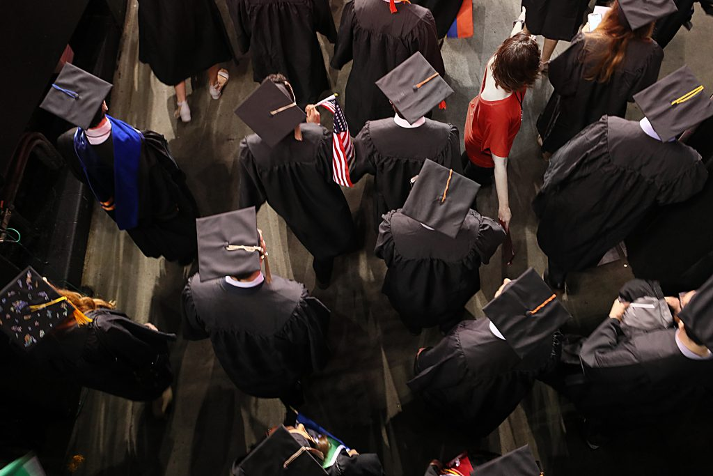BOSTON, MA - MAY 4: The procession begins as the graduates enter the arena during the Northeastern University commencement at the TD Garden in Boston on May 4, 2018. (Photo by Suzanne Kreiter/The Boston Globe via Getty Images)