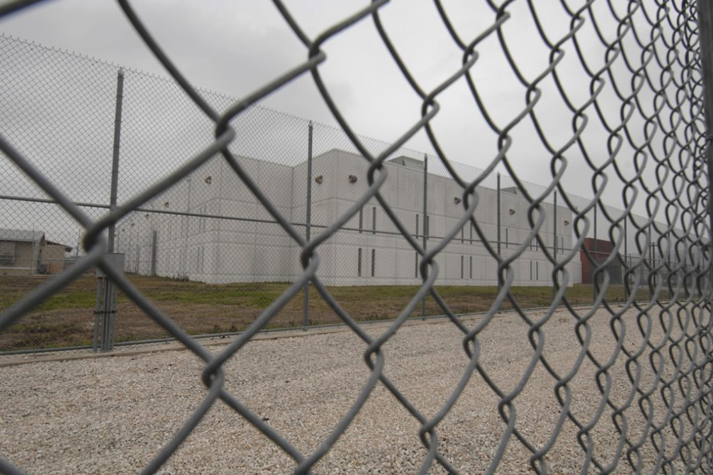 The perimeter fence of the T. Don Hutto detention facility of the Immigration and Customs Enforcement center is seen.