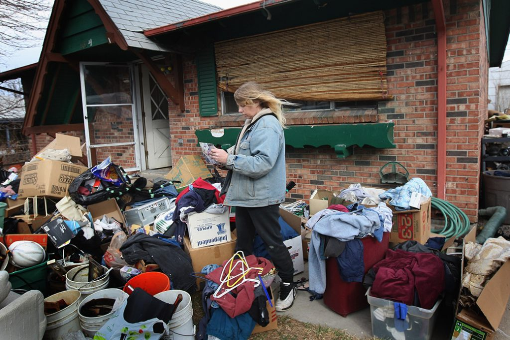 A woman looks over an album of family photos after an eviction team removed all her possessions from her foreclosed home in Colorado, February 2009.