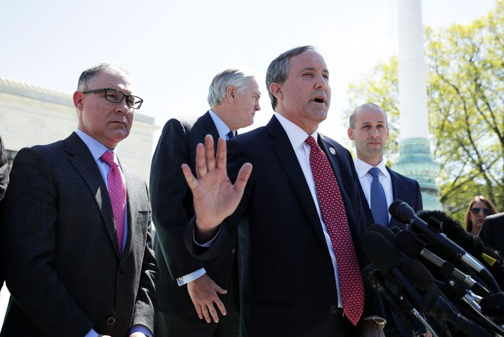 Texas Attorney General Paxton speaks to members of the media in front of the U.S. Supreme Court in Washington, D.C., on April 18, 2016.