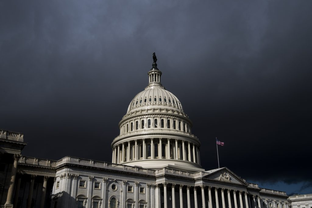 Storm clouds pass over the dome of the U.S. Capitol building, January 2018.