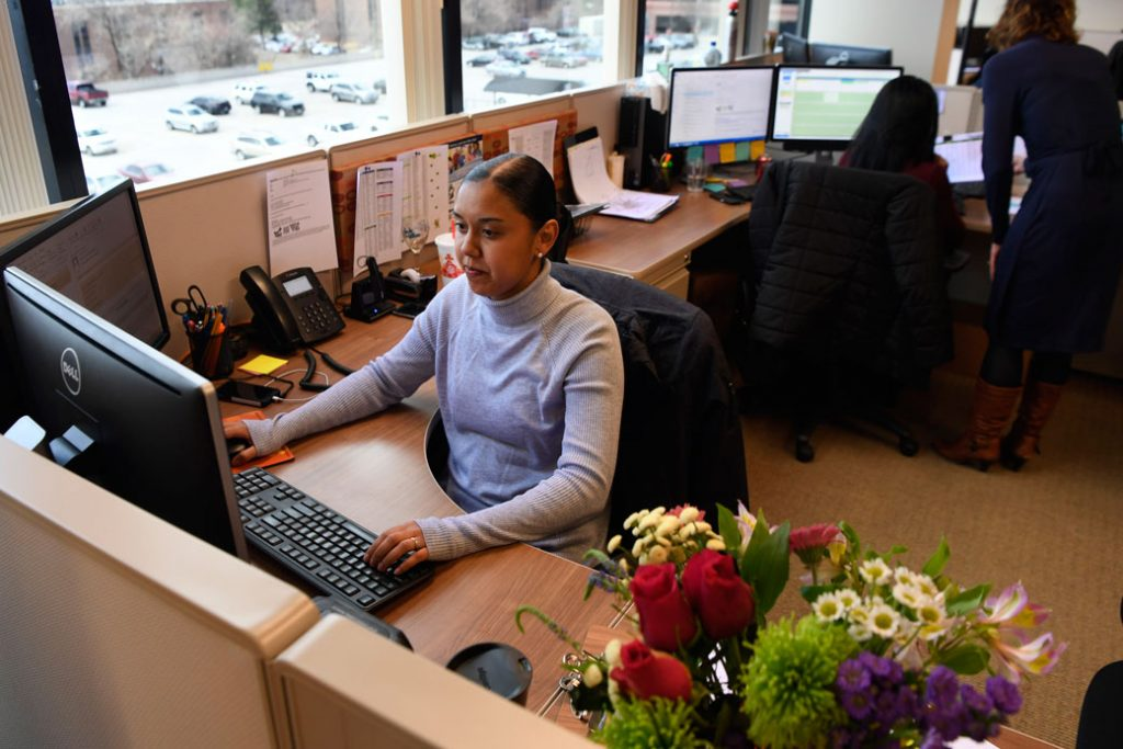 An employee works at her desk in Aurora, Colorado, on March 19, 2017.
