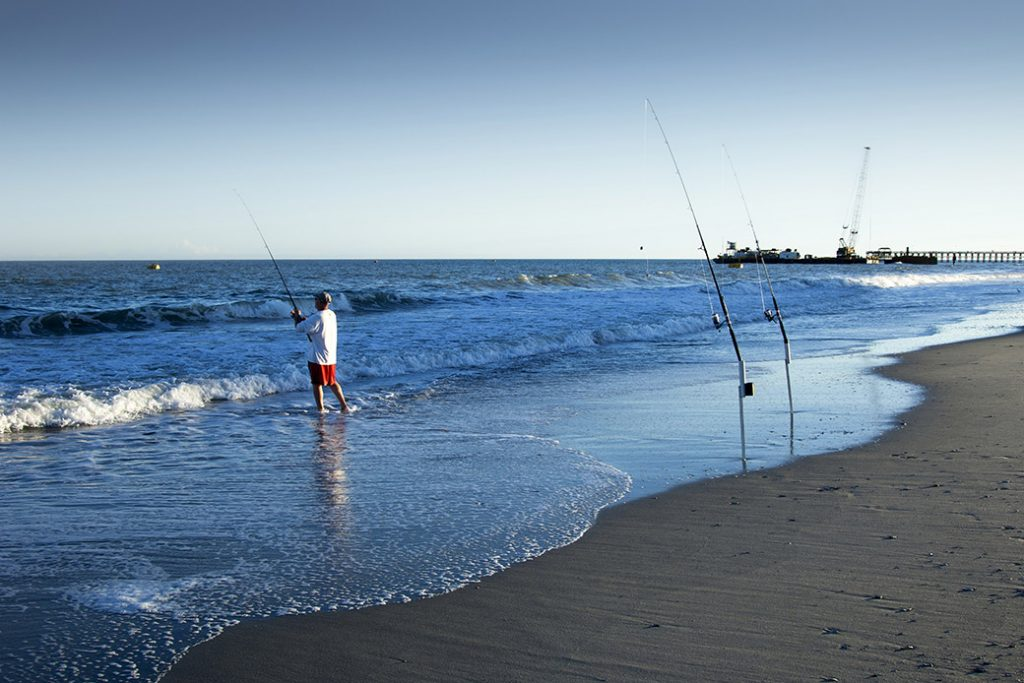 People are seen fishing in Myrtle Beach, South Carolina.