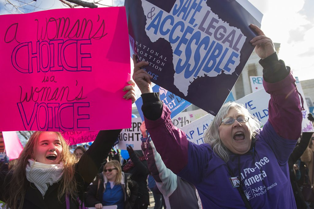 Supporters of legal access to abortion rally outside the U.S. Supreme Court in Washington, March 2, 2016.