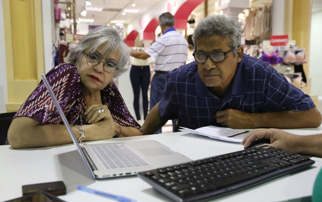 A couple explores different insurance plans available under the Affordable Care Act on November 1, 2017, in Miami.