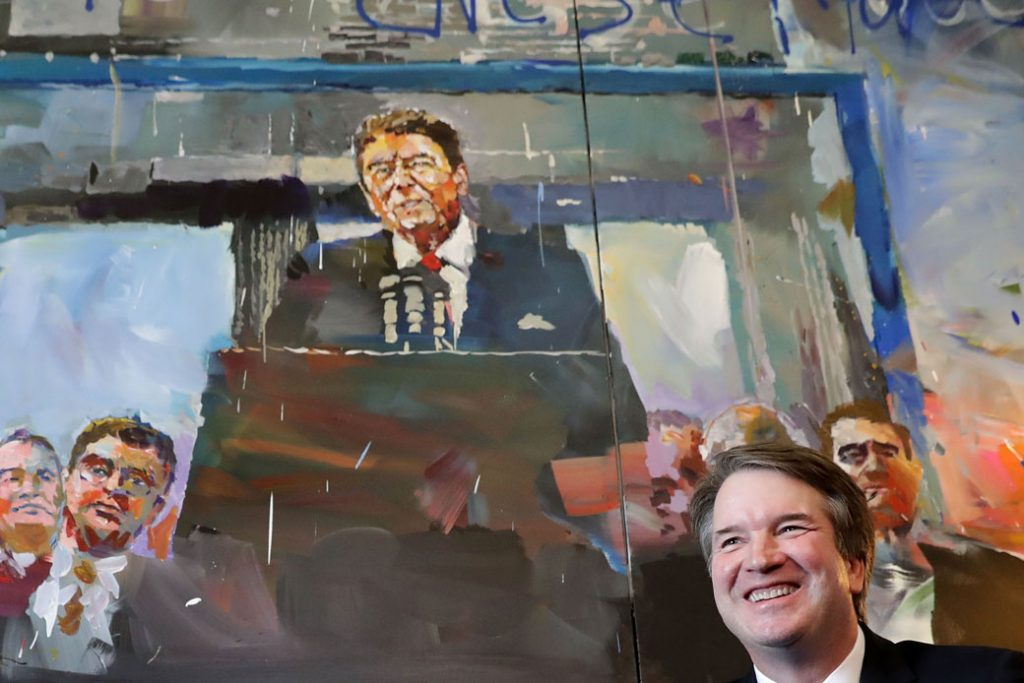 Supreme Court nominee Judge Brett Kavanaugh poses for photographs in front of a painting of President Ronald Reagan, July 17, 2018.