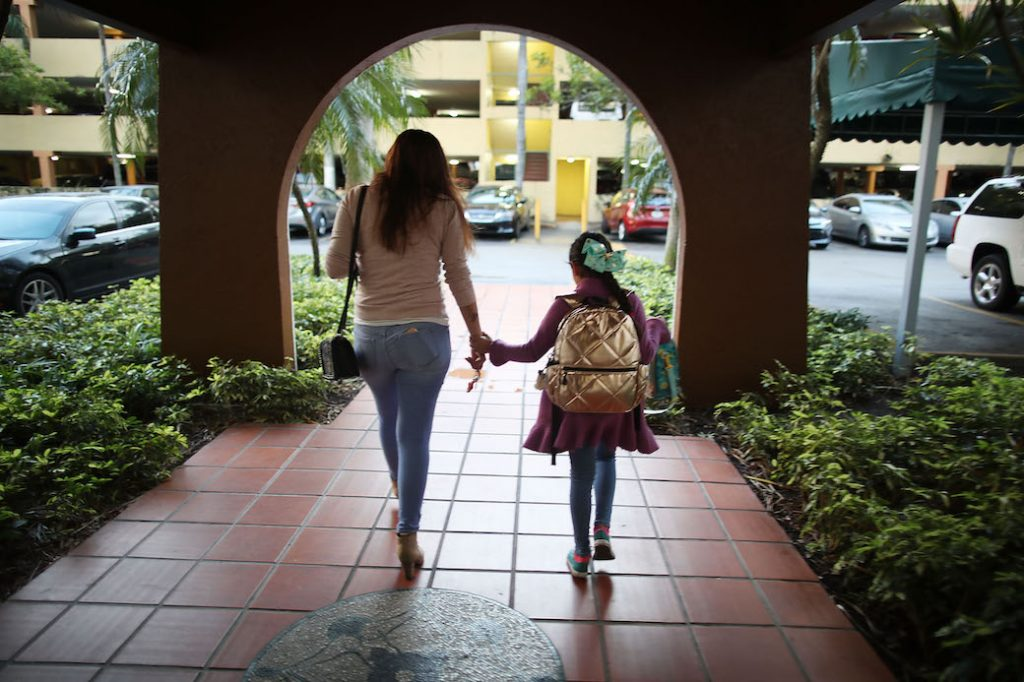 Lorena Jofre, a DACA recipient, walks her daughter to school before driving to work in Miami, Florida, February 2018.