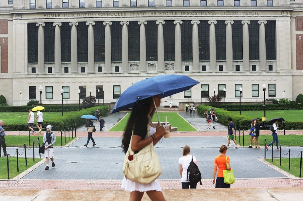 Students walk on their university campus in July 2013, New York, NY.