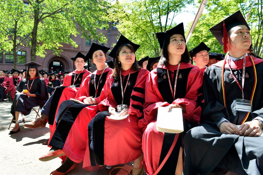 Students attend Harvard University's 2018 367th Commencement at the university in Cambridge, Massachusetts, on May 24, 2018.
