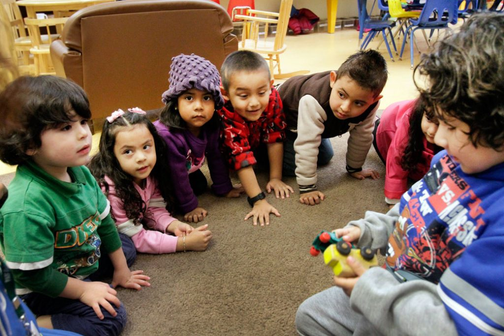 Preschoolers engage in a toy sharing learning exercise at an early childhood education program in Los Angeles, March 2013.