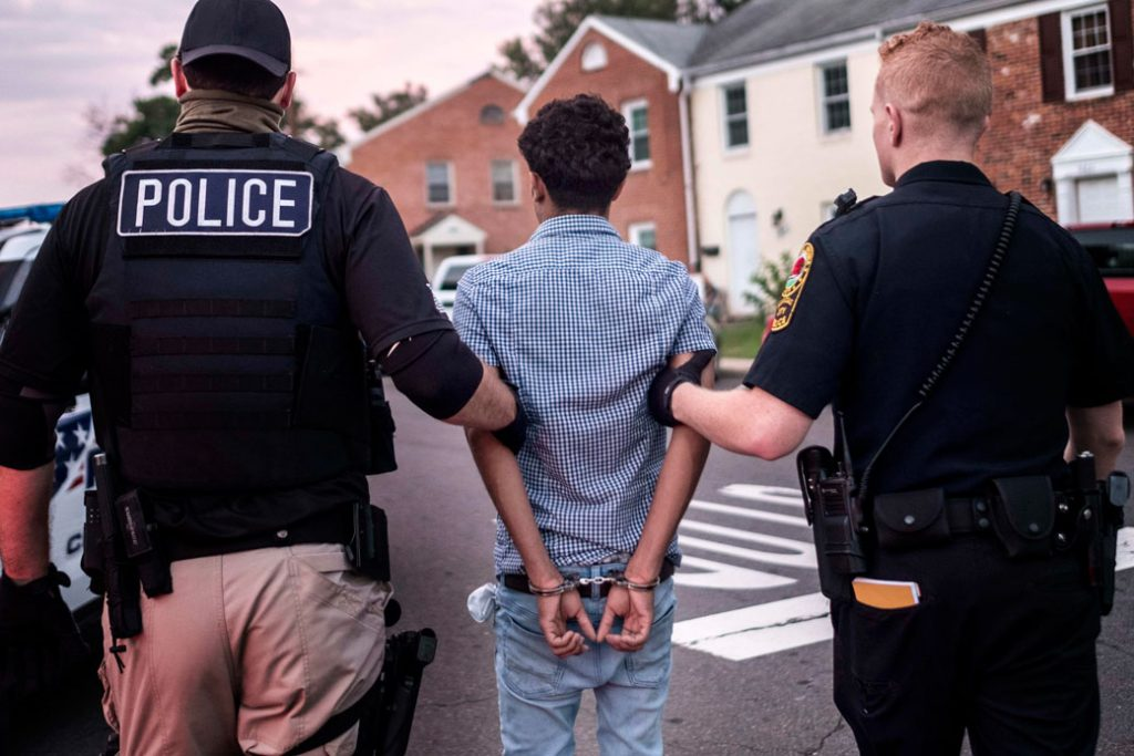 Officers arrest an alleged MS-13 gang member in Manassas, Virginia, on August 10, 2017.