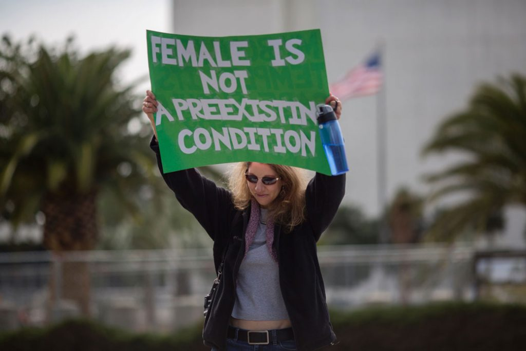 A woman in Los Angeles protests Trump administration policies that threaten the Affordable Care Act, Medicare, and Medicaid, January 25, 2017.
