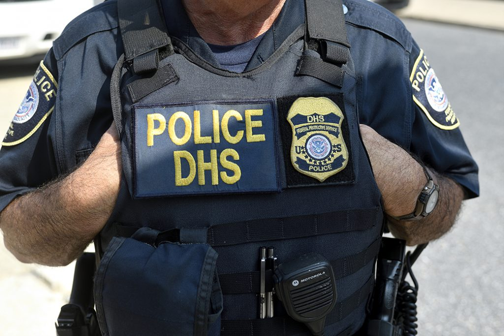 Law enforcement officers of the Philadelphia Police Department, Homeland Security, and National Park Service stand by as protestors build a small encampment outside a Department of Homeland Security U.S. Immigration and Customs Enforcement office in Pennsylvania, July 2018.
