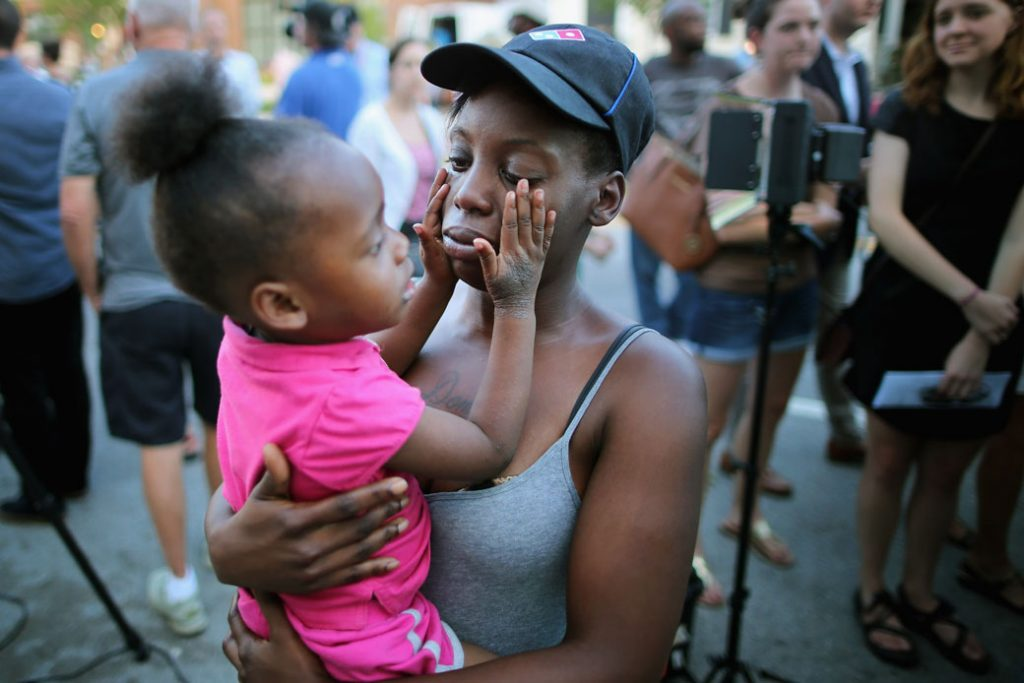 A mother holds her 2-year-old daughter in Charleston, South Carolina.