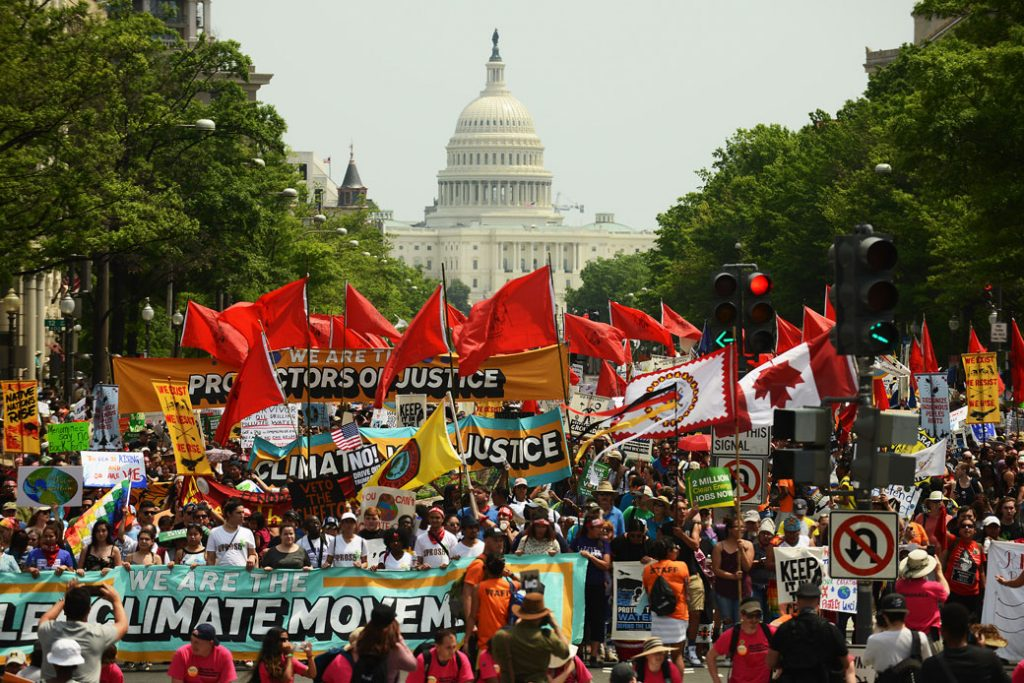 People march from the U.S. Capitol to the White House for the People's Climate Movement in Washington, D.C., on April 29, 2017.