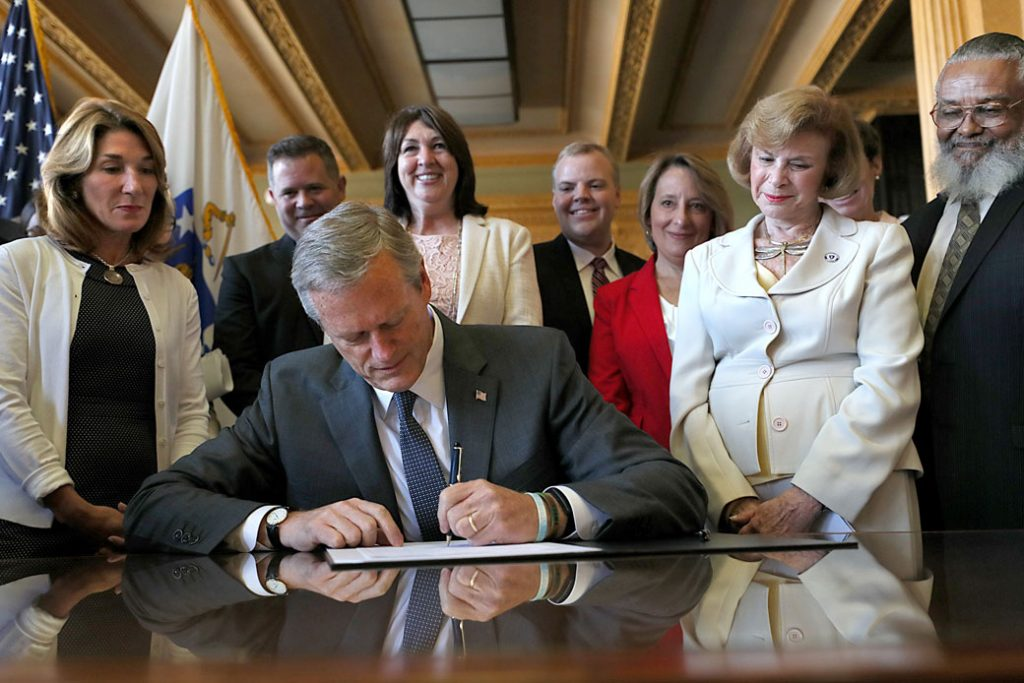 Massachusetts Gov. Charlie Baker (R) signs legislation repealing the state's archaic anti-abortion laws on July 27, 2018.