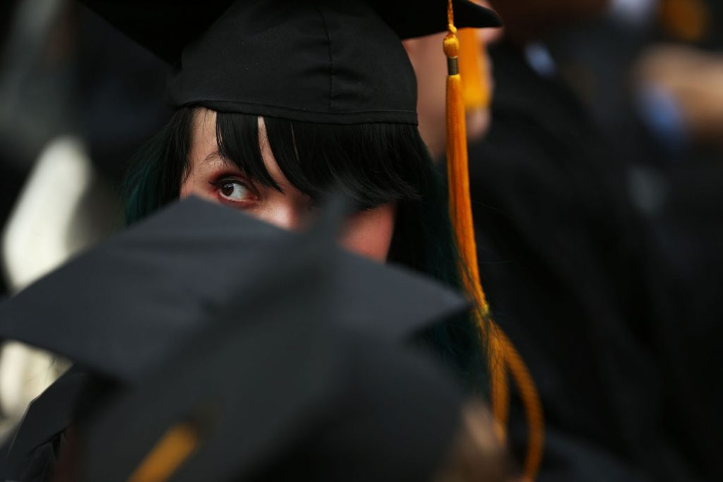 A student watches the commencement address during graduation ceremonies at the City College of New York on June 3, 2016.