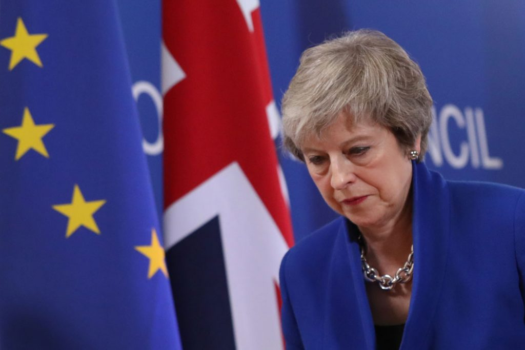 British Prime Minister Theresa May departs her press conference following the European Council's special session over Brexit on November 25, 2018, in Brussels, Belgium.
