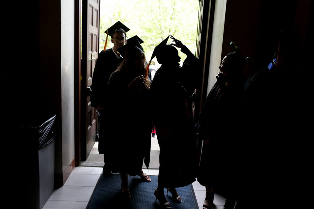 Students arrive at their undergraduate commencement in Massachusetts, May 2018.
