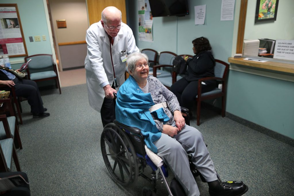A doctor in Milton, Massachusetts, wheels his patient into his office, February 2018.