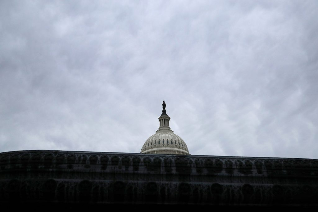 The U.S. Capitol dome stands under a cloudy sky, January 2019.