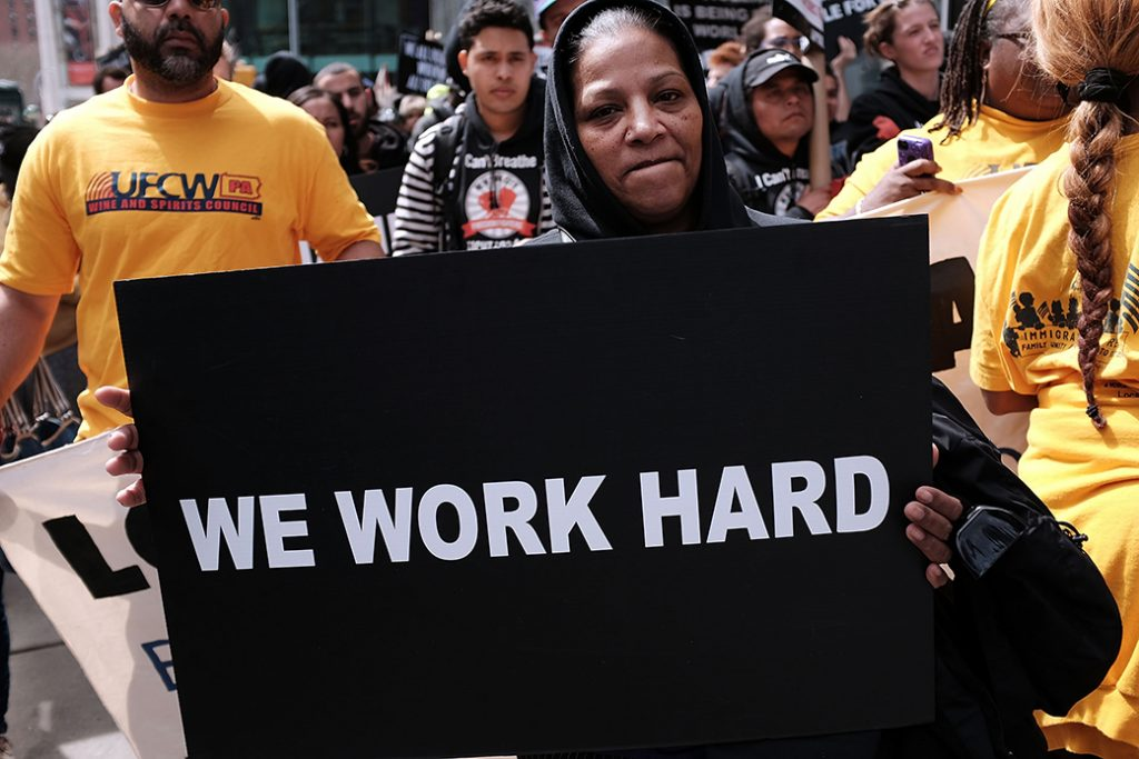 Low-wage workers, many of them in the fast food industry, join with supporters to demand a minimum wage of $15 per hour, April 15, 2015, in New York City.