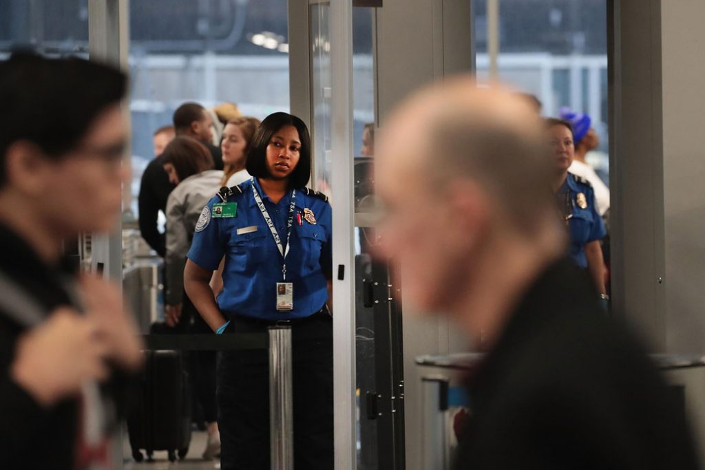 A Transportation Security Administration agent works at O'Hare International Airport in Chicago during the partial government shutdown on January 7, 2019.