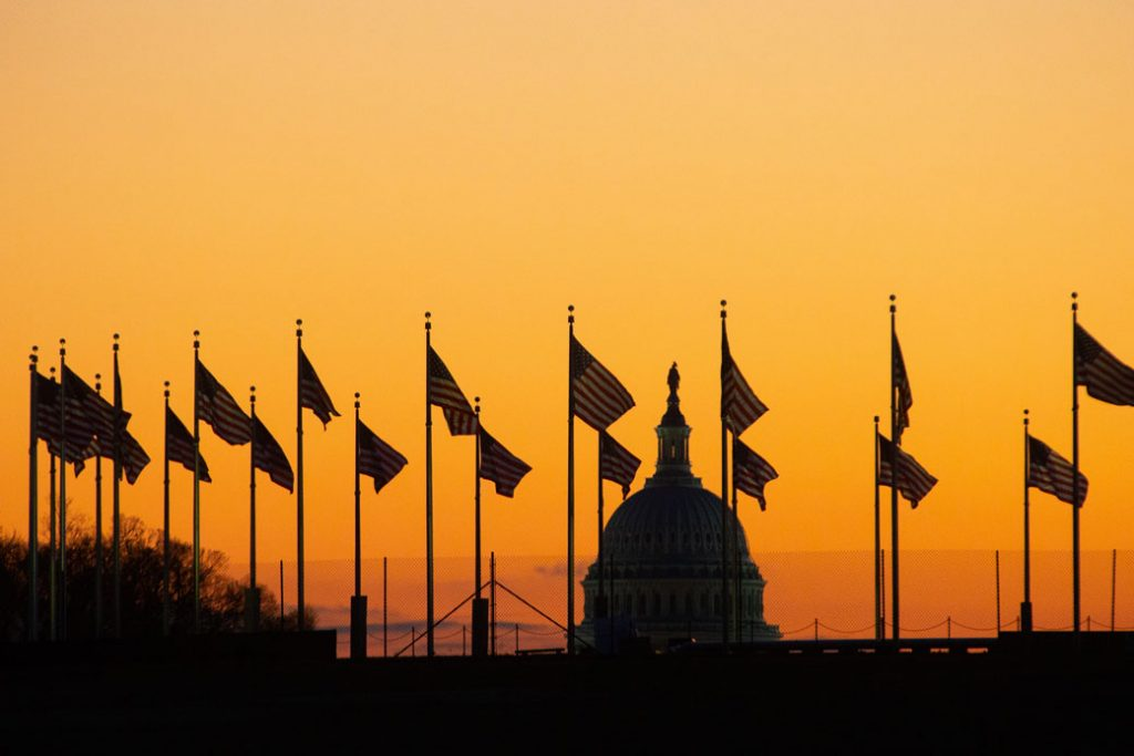 The sun rises behind the U.S. Capitol in Washington, D.C., January 2019.