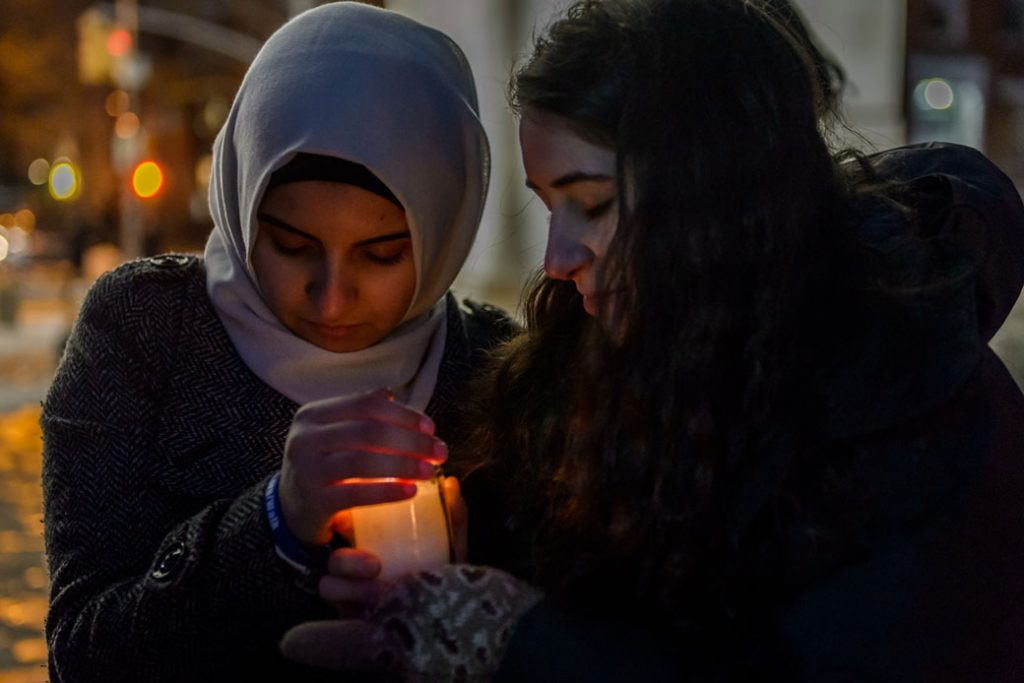 An interfaith candlelight vigil remembers victims of the Holocaust, New York, January 2016.