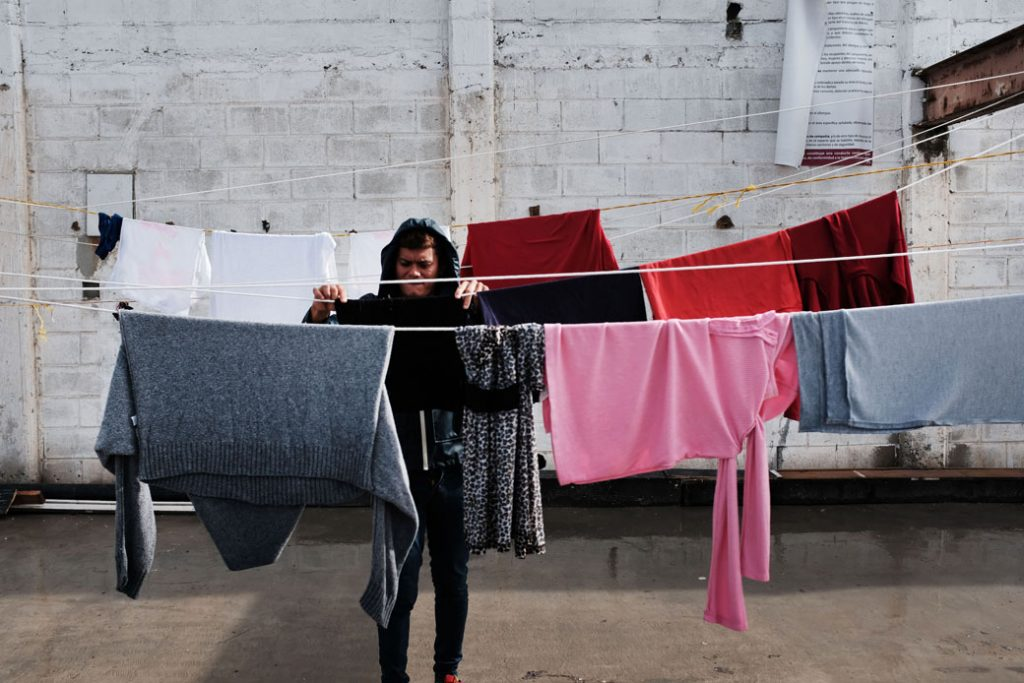 A member of the migrant caravan does laundry inside a migrant shelter in Tijuana, Mexico, January 2019.