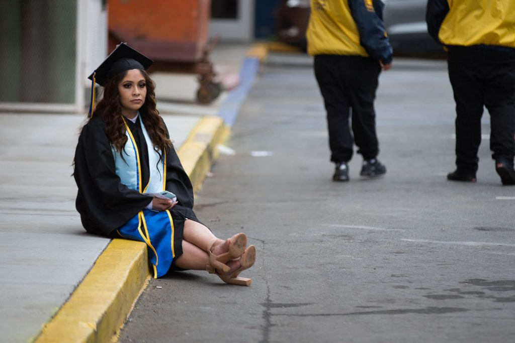 A college student waits for her commencement ceremony to begin in San Jose, California, on December 19, 2018.