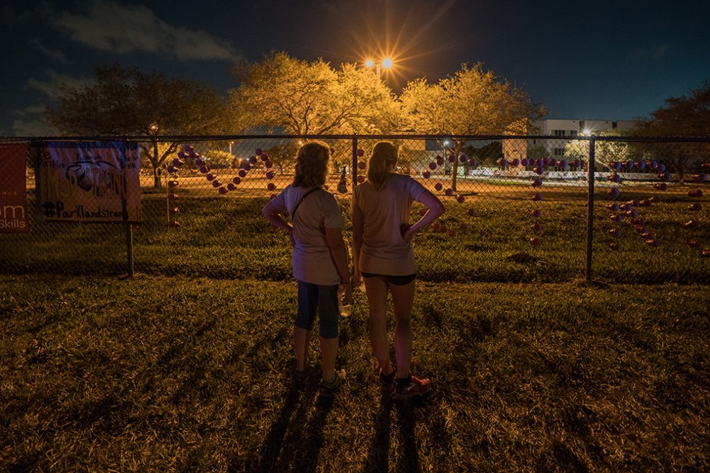 Students view a memorial at Majory Stoneman Douglas High School on February 25, 2018, in Parkland Florida.
