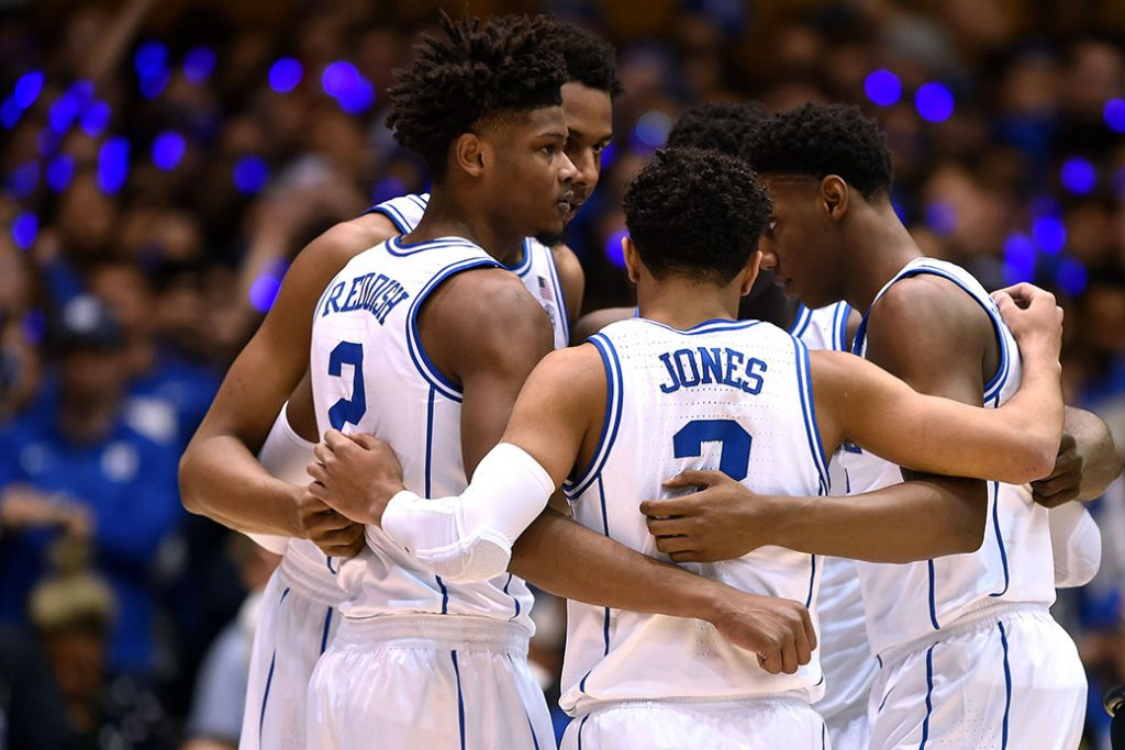 DURHAM, NC - FEBRUARY 20: Cam Reddish #2, Marques Bolden #20, Tre Jones #3, Zion Williamson #1 and RJ Barrett #5 of the Duke Blue Devils huddle against the North Carolina Tar Heels in the first half at Cameron Indoor Stadium on February 20, 2019 in Durham, North Carolina. (Photo by Lance King/Getty Images)