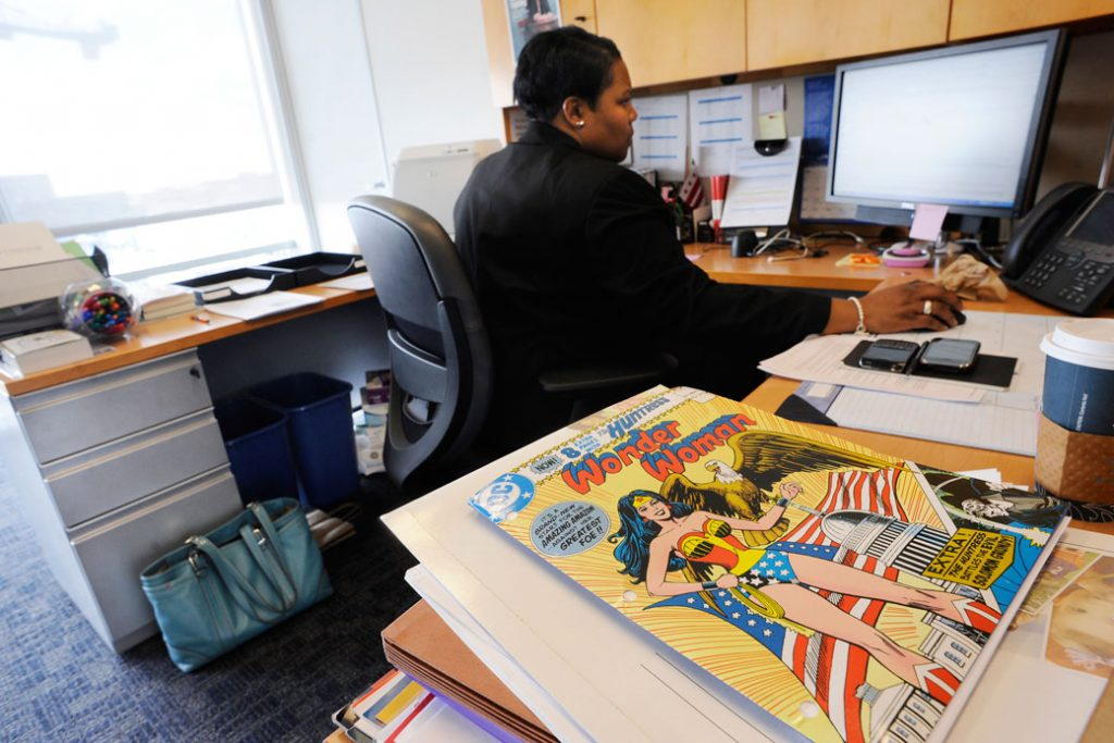 A District of Columbia Public Schools employee sits at her office desk in Washington, January 2011.