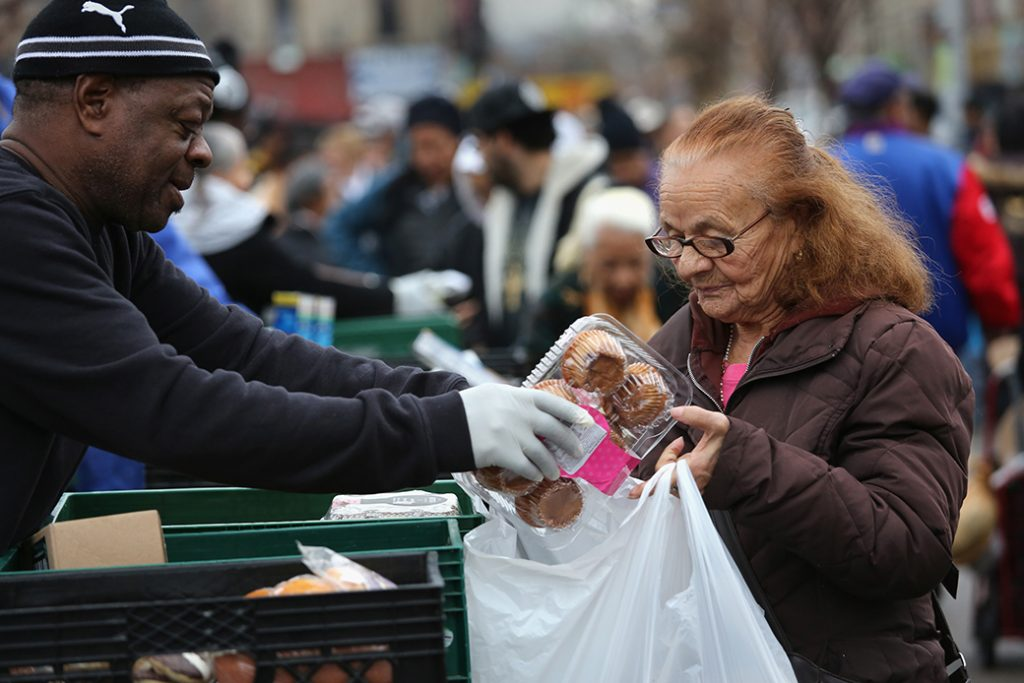 Brooklyn residents receive free food as part of a Christian outreach program, December 2013, in the Brooklyn borough of New York City.