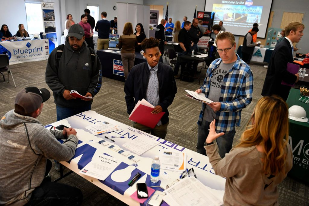 Career fair attendees meet with prospective employers about job opportunities in Northglenn, Colorado, April 2017.