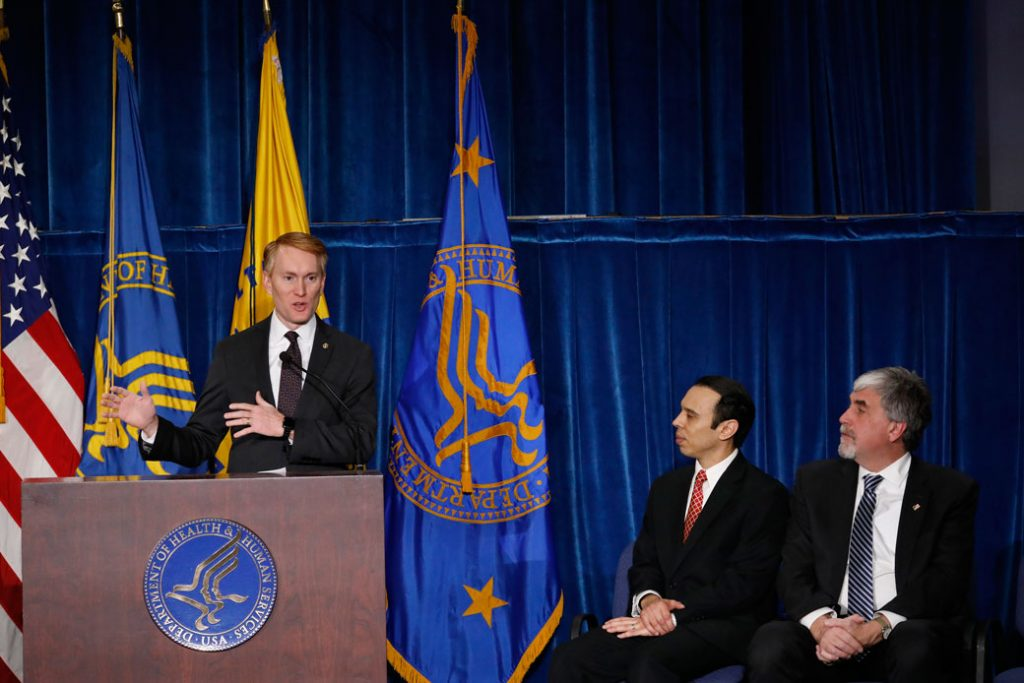 OCR Director Roger Severino, center, and then-acting HHS Secretary Eric Hargan, right, watch Sen. James Lankford (R-OK) speak at a news conference announcing the creation of a Conscience and Religious Freedom Division on January 18, 2018, in Washington, D.C.