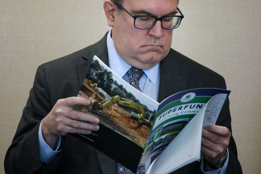 Environmental Protection Agency (EPA) Administrator Andrew Wheeler looks at a pamphlet about Superfund sites, March 2019.