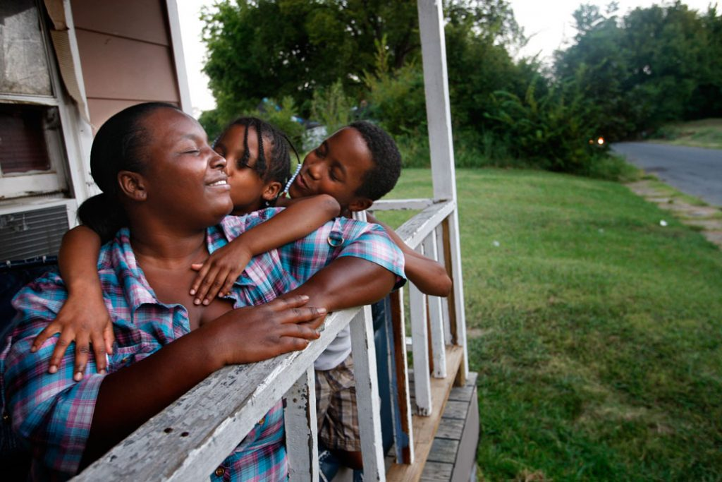 A mother and her two children enjoy a summer evening in Memphis, Tennessee, August 2012.