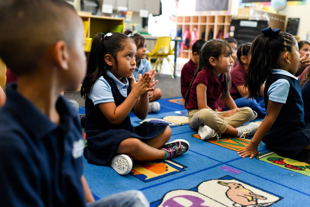 Kindergarten students in Denver participate in an activity during the first day of school, August 2018.