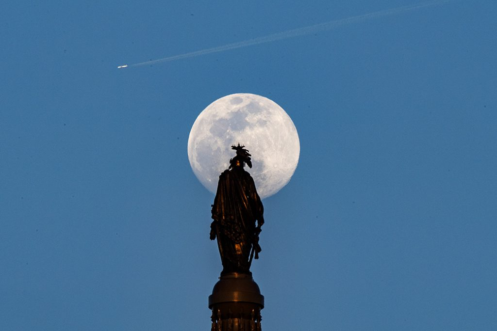 The Worm Moon rises behind the Statue of Freedom on top of the dome of the U.S. Capitol, March 2019.