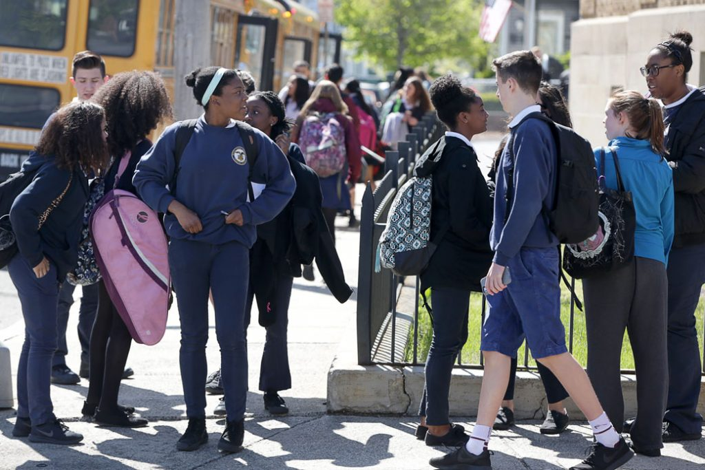 A group of students stands outside their school in Malden, Massachusetts, May 2017.