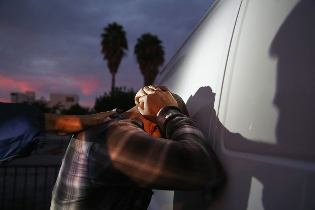 A man is detained by U.S. Immigration and Customs Enforcement agents in Los Angeles, October 2015.