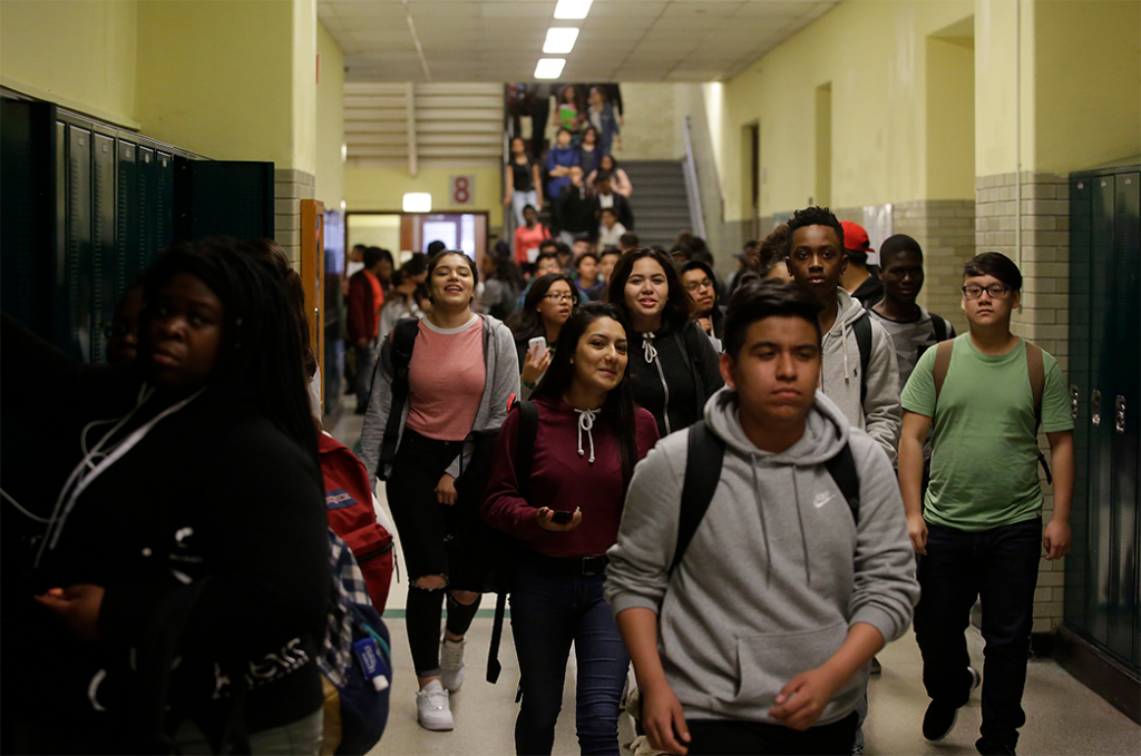 Students walk through the hallway after classes were dismissed at Senn High School on May 10, 2017.