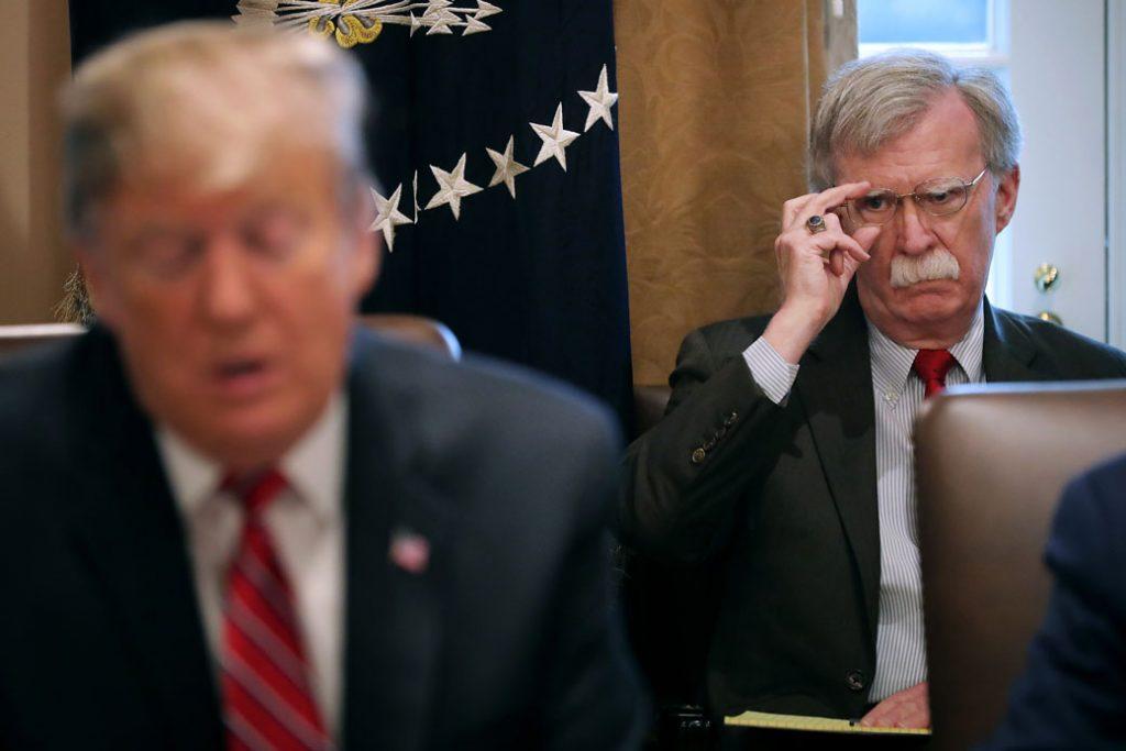 National Security Adviser John Bolton listens to U.S. President Donald Trump, February 2019.