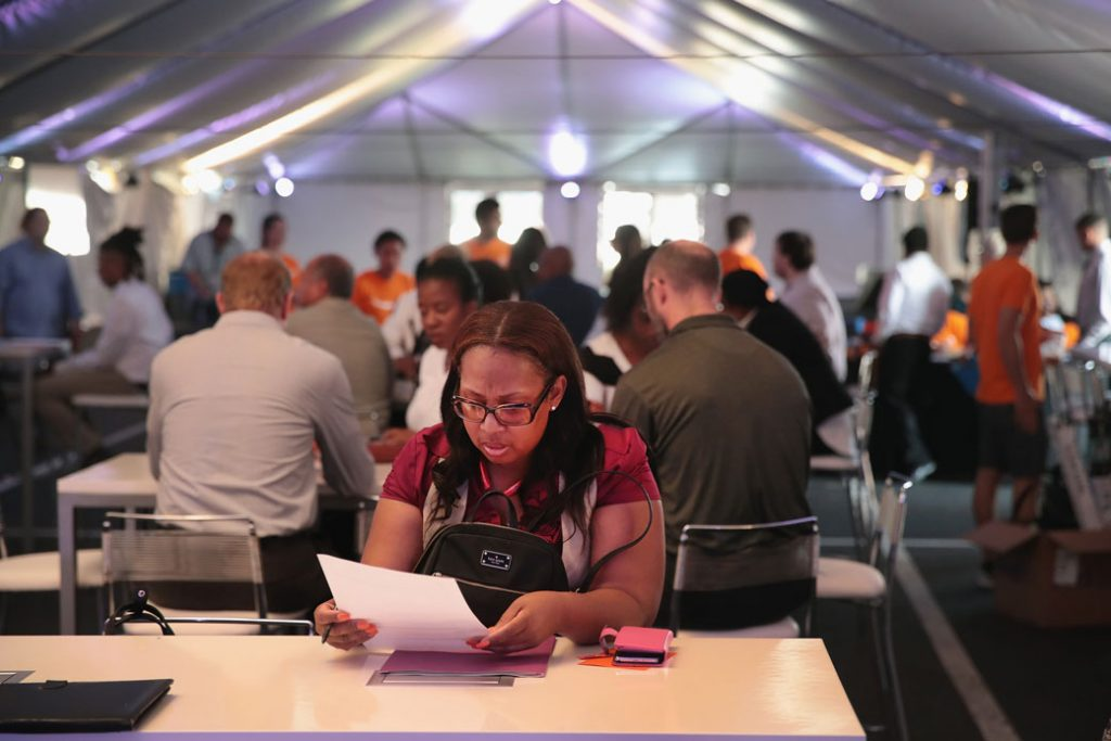 Applicants attend a job fair in Romeoville, Illinois, August 2017.