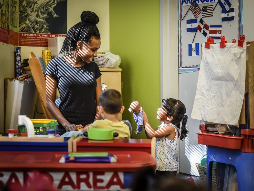 Tyonna Stinnie, left, works toward her certification at a Child Development Center training for potential child care workers in Washington, D.C..