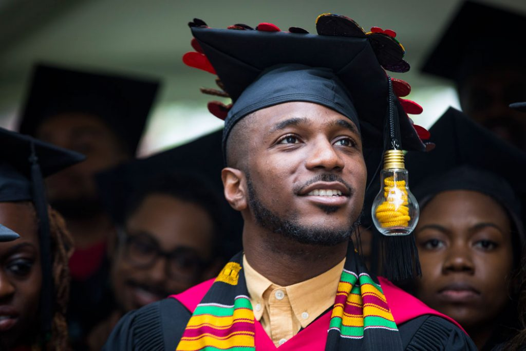 A master's degree graduate listens to speakers during a commencement ceremony at Harvard University, May 2017.