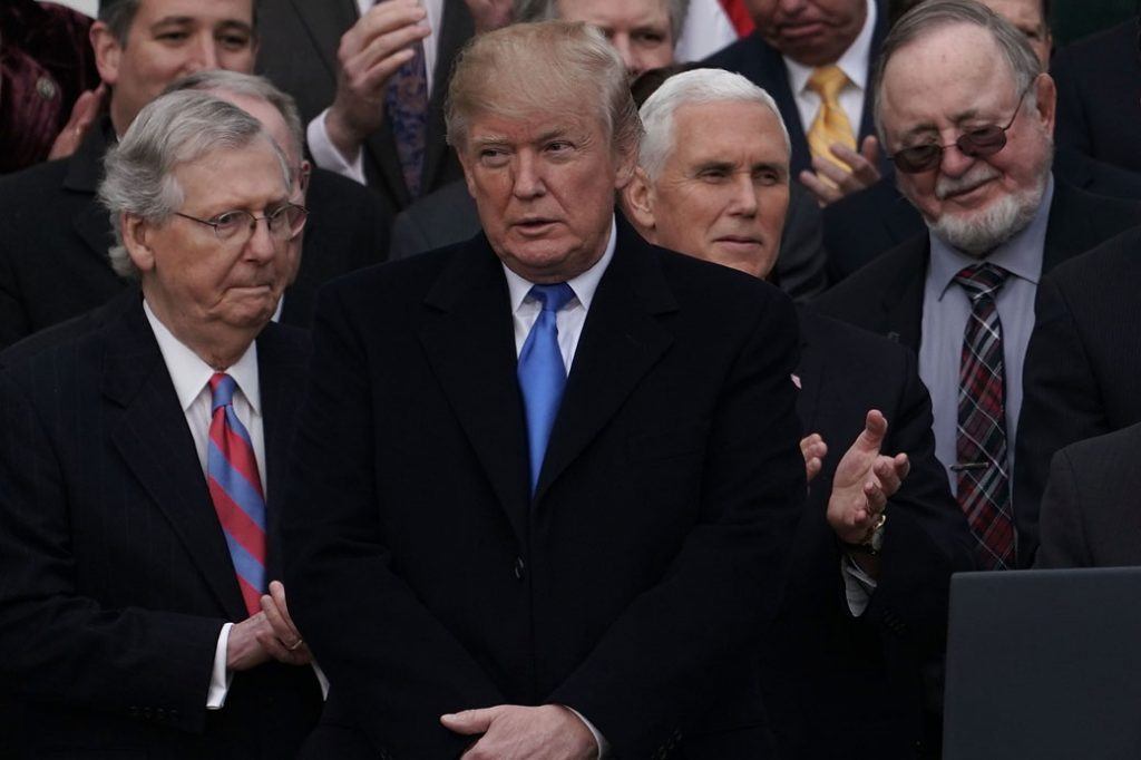 President Donald Trump and congressional Republicans celebrate the passage of the Tax Cuts and Jobs Act at the White House in Washington, D.C., December 2017.